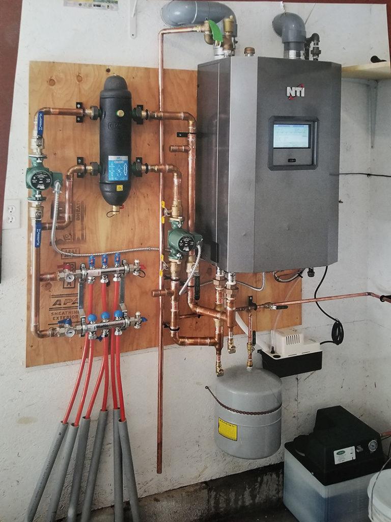 High Efficiency Boiler Connected to Infloor Heating Lines
